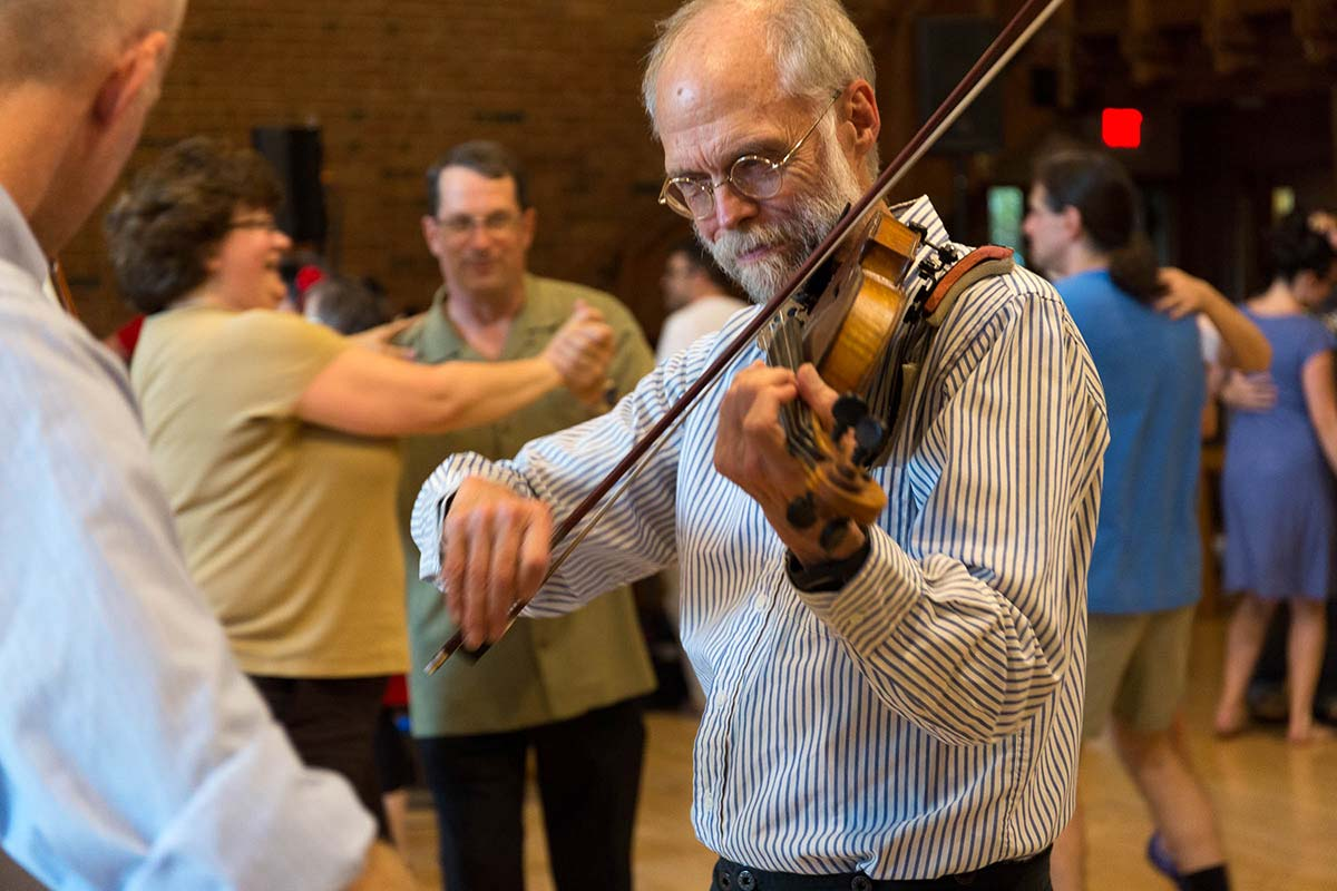 David Kaynor playing the fiddle at a dance