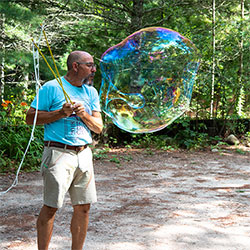 Blowing a giant bubble at camp