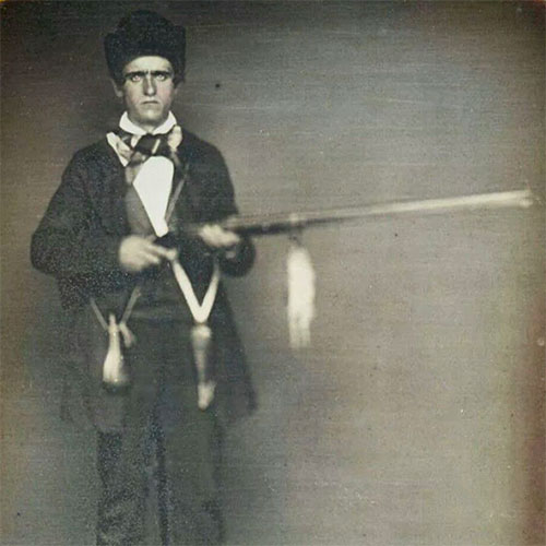 Daguerreotype photo of a young man with a rifle